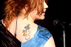 Kelly Clarkson's Puzzle Tattoo... Something like this, with something of grama inside