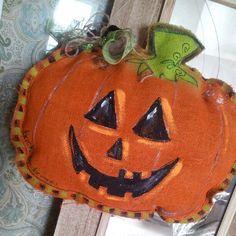 Halloween Pumpkin Burlap Door Hanger Jack-O-Lantern. $30.00, via Etsy.