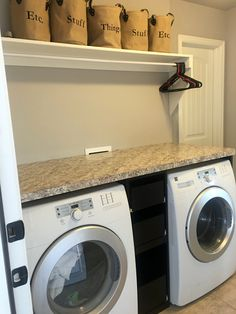 Laundry Room With: Counter Over The Washer Dryer, Slide Out Drawers In  Between.