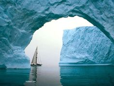 Icebergs and sailboat