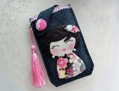 Show your style and have some fun with this beautifully 90% hand-stitched and 10% machine embroidery felt pouch to protect your cell phone or...