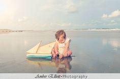 Baby photography; beach; vintage sailboat