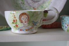 Large girl and bird teacup. $92.00, via Etsy. Julie Whitmore
