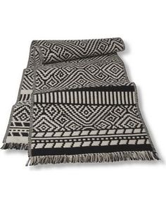 Find Kitchen Textiles at Target.com! Add some bohemian flair to your dining room table with a Threshold Kilim Table Runner. This gorgeous black and white tribal pattern is inspired by the legendary beauty of Turkish Kilim Rugs. Re-create the bold patterns and textures of the Silk Road in your own home with this decorative runner. 100% cotton. Size: 14X72. Color: Black.