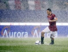 Francesco Totti, wetter than an otter's pocket during Roma's washed-out Serie A match against Sampdoria in the Stadio Olympico, 2008 (AP Photo/Gregorio Borgia)