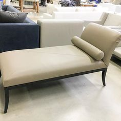 The Salon Chaise tailored in taupe Holly Hunt leather.  interior design, furniture, chaise lounge, seating, living room, formal furniture, bedroom furniture, modern, transitional design, traditional, contemporary, settee, high-end, luxury, sitting room, lounge seating, Maxine Snider Inc.