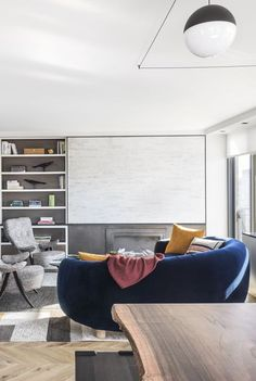 A TV is an obvious eyesore in any room—but that doesn't mean you have to choose between style and movie marathons. Condo Living Room, Home And Living, Hidden Tv, Framed Tv, Bookshelves, Living Room Designs, Beautiful Homes, Design Inspiration, Interior Design