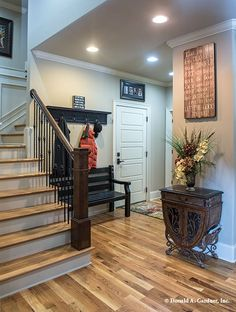 A bench and coat rack are the perfect additions for the foyer or near the garage entry. The MacAllaster #838 - http://www.dongardner.com/house-plan/838/the-macallaster. #Mudroom #HomeDesign #FloorPlan