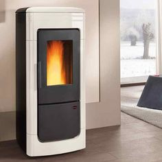 Pellet thermo-stove with majolica covering Pellets, Pellet Stove, Home Appliances, Wood, Stoves, Architects, Home Decor, House Appliances, Decoration Home