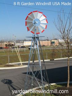 Made in USA 8 foot steel Garden Windmill.  This is the original Garden Windmill - do not be fooled by the cheap Chinese copies!!! 24 inch base 22 inch wheel - will last for years.   $124.95