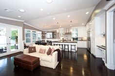 Love the contrast of the floors and cabinets with the grey paint and stainless steel appliances