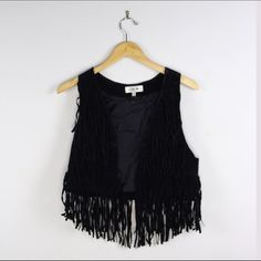 Fringe Vest MUST GO Black faux suede fringe best. Only signs of wear is the left shoulder from being hung on the hanger. Runs small; fits like a medium. No trades or transactions other than poshmark. Forever 21 Jackets & Coats