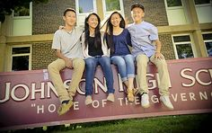 From one Hmong family, four of Johnson High's top students - From left, Jethro (16), Josalyza (17), Jepheny (18) and Justin (19) Thao pose for a photo in front of Johnson High School in St. Paul on Wednesday, July 23, 2014. (Pioneer Press: Ben Garvin)