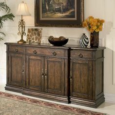 Aspen Mountain Decor Sideboard Western Cabinets and Buffets - Rustic yet refined styling. Carved from solid hardwood with an oak veneer top and rich mahogany finish. Drawers and cabinets for storage accented with decorative hardware.