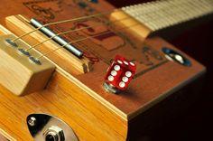 "J. Grotto Churchill box. Maple neck with oak/maple peg head; maple & mahogany heel. Maple fret board with mahogany dots. Maple/mahogany bridge w/rod piezo pickup. 23"" fret scale, Tuned: G (G-D-G)."