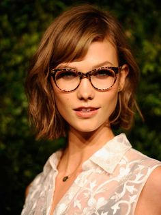 Karlie Kloss glasses http://beautyeditor.ca/2013/06/03/hey-four-eyes-if-you-wear-glasses-then-you-probably-need-these-makeup-tips/