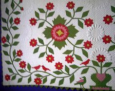 I love pink, red, and green in an applique quilt. Look at how close the cross-hatch background quilting is. I made ONE quilt with hand-quilting cross-hatching this close together. Granddaughter Bianca owns it. It took forever to finish, but I'm so glad I did it.