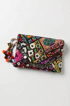 ethnic textile clutch w/ pompom tassel