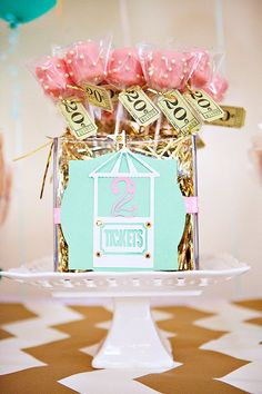 """Pink & aqua vintage ticket booth with felt carousel banner – Glittery """"2"""" sugar cookes, pink rice krispie pops, & pretty white chocolate carousel lollipops"""