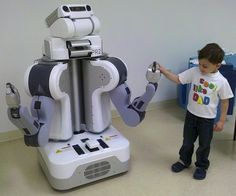 In his lab at Brown University, Chad Jenkins and his students train and program Willow Garage's PR2 personal robot.