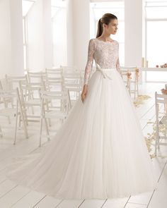 A-line lace and tulle wedding dress with long sleeves, bateau neckline and V-back. 2018 Aire Barcelona Collection.