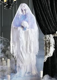 Enchanting and terrifyingly lifelike, the Ghostly Bride Animated Figure is sure to spook your guests this Halloween and leave a lasting impression.