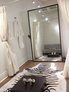 White: Montreal's Chic Bridal Boutique I like having the robe in the dressing room for between trying dresses on. And a simple curtain is all you need.