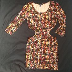 Forever 21 tribal print dress Tribal print dress with open sides. Black, orange, pink, and red. Forever 21. Size medium. Pre-loved, but in good condition! Forever 21 Dresses