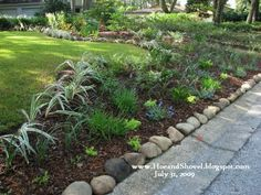 Low maintenance front yard landscaping. It looks like this goes right to the very low street curb. How nice!
