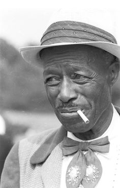 Son House, grinnin in your face.
