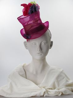 Curaçao   Stephen Jones   Purple crin mini top hat shape on a ribbon covered hairband, with purple, crimson and green silk flowers and leaves   A 'Miss Jones' piece from the Hot House collection (Spring-Summer 2015)   Made in England