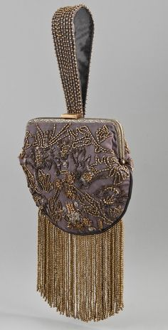 Club Monaco -Cora Wristlet - This hand-embellished wrist-let features bead and sequin detailing. Beaded fringe and hinged closure. Lined interior features patch pocket.