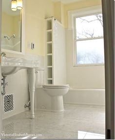 Love this extra storage built into the tub space