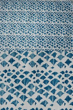 "Lina Rennell Yardage Ikat Cat at Beklina:   Hand printed Ikat Cat in pacific blue on natural 100% organic cotton chambray. 60"" width"