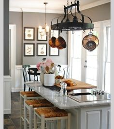 I like this countertop with white cupboards and grey walls