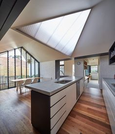 This contemporary homes takes roof lines and building geometry to a new level! The roof even adds interest to this kitchen!