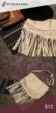 Boho Fringe Purse White faux leather fringe purse. Cross body or over the shoulder. The strap is adjustable or you could knot it for a trendy look. From Target. Brand new with tags. Merona Bags Crossbody Bags