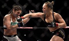 Ronda Rousey of the United States punches Bethe Correia of Brazil in their bantamweight title fight during the UFC 190 Rousey v Correia at HSBC Arena on August 2015 in Rio de Janeiro, Brazil. Ronda Rousey, Kickboxing, Mma Fighting, Fighting Poses, Muay Thai, Jiu Jitsu, Rowdy Ronda, Catch, Ufc Women