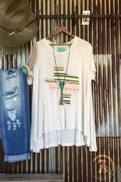 - Serape Texas tunic - Colorful serape overlay Texas detail - Short sleeve flowy oatmeal tunic/oversized tee - Slight hi-lo hem with longer sides - Fits true to size through shoulders and sleeves - Ex