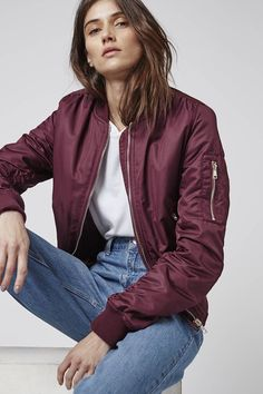 Do utilitarian cool in our burgundy MA1 bomber. Layer over jeans and a crisp white tee for casual cool. #Topshop