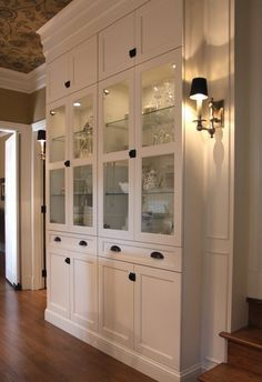 Built-in from Ikea Billy cabinets, add side panels with sconces