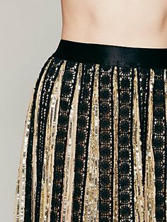 Gold mesh maxi with metallic sequins  http://rstyle.me/n/d5ipbnyg6