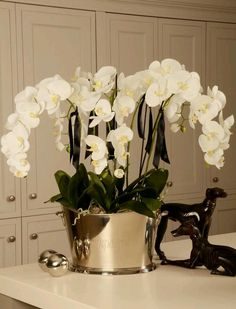 Silk flower arrangement silk orchids lend themselves to realistic designers of artificial silk flower arrangements and suppliers of artificial flowers artificial trees artificial plants and artificial greenery mightylinksfo