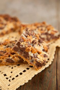 Paula Deen Five Layer Bars made with pecans, butterscotch & chocolate morsels, coconut, & graham crackers plus sweetened condensed milk.....THIS COULD ALSO BE MADE FOR A MASON JAR GIFT WITH RECIPE ATTACHED