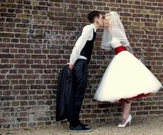 I just like the idea of a red petticoat underneath a wedding dress. Longer, though.