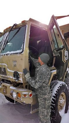 Spc. Eric Mendoza from Worcester, with the 1166th Transportation Company, Worcester prepare their LMTVs for tide and flood checks here as part of the Guard's response to Winter Storm Hercules, Jan. 3, 2014.