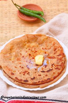 Aloo paratha is a tasty Indian breakfast dish.  It is potato stuffed flat bread - very tasty and easy to make