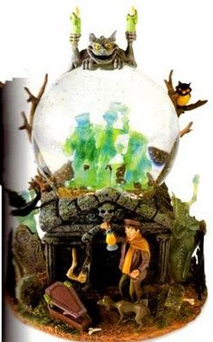 "This is a seriously awesome snowglobe. The Haunted Mansion. According to the description, the ghosts light up and rock back and forth, just like in the ride, while playing ""Grim Grinning Ghosts"". It was featured in the online Disney catalogue in 2002-2003."