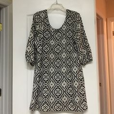 Black and White Large ING Dress It's very cute. It is a mini dress. Only had for a year. Bought it for graduation. Worn a few times. You can wear it anyway you want and dress it up with jewelry. I love this dress. It is one of my favorites. Stops a little above the knee. Ing Dresses Mini