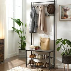 Or this storage rack with plenty of room to organize your coats, bags, and shoes. It's slim design makes it easy to fit into a tight corner or a tiny foyer.
